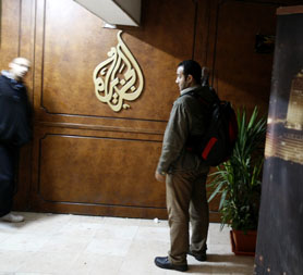 Al-Jazeera employees stand at the pan-Arab television channel's bureau in Cairo on January 30, 2011. Egypt has ordered a shutdown of Al-Jazeera's operations, the official MENA news agency said (Getty)