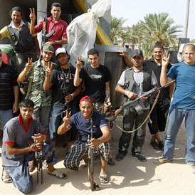 Libyan rebels celebrate victory on the Misrata frontline (Reuters)