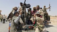 Libyan rebels celebrate the capture of al-Qawalish (Reuters)