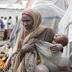 A woman waits with her child for medical treatment at Aden Adde hospital near a displaced persons camp in Waberi (Reuters)