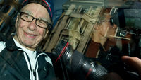 News Corp chief Rupert Murdoch leaves his London home on July 11, 2011. (Getty)