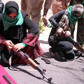 Pro-Gaddafi women given gun training by troops near Gharyan (Getty)