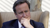 David Cameron flies home to deal with the phone-hack crisis (Reuters)