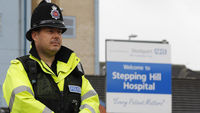 A police officer outside Stepping Hill Hospital (Reuters)