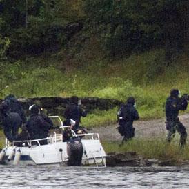 Norwegian anti-terror police arrive at Utoya island (Getty)