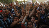 US condemns Syria violence as thousands flee