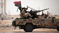 Libya: rebels battle Gaddafi forces south of Tripoli
