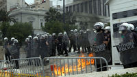 Riot police guard the Greek parliament during clashes at anti-austerity protest in Athens (Reuters)