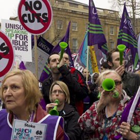 Unison members marching with their banners at the March for the Alternative, organised by the Trades Unions Congress in London (Getty)