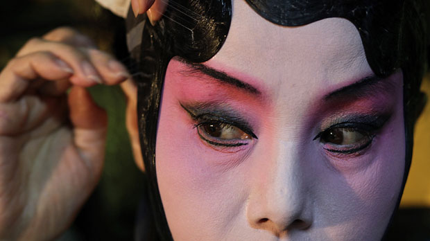 A dancer prepares for a performance of the Peony Pavilion