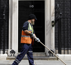 Street cleaner outside 10 Downing Street (Reuters)