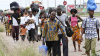Residents flee with their belongings after clashes in Abobo (reuters)