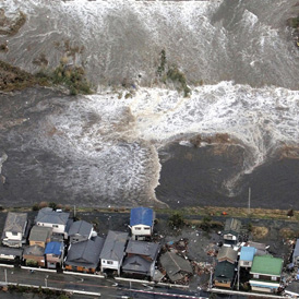 Houses are damaged by water following a tsunami and earthquake in Ibaraki city Japan (Reuters)