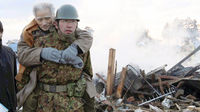 A man is rescued by a member of Japan's security forces