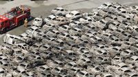 Burned-out cars are pictured at Hitachi Harbour in Ibaraki Prefecture in northeastern Japan
