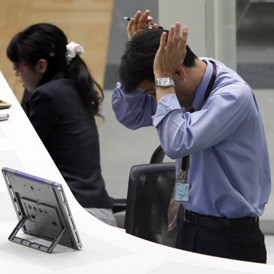 Nikkei traders feel the strain as stocks plummet.