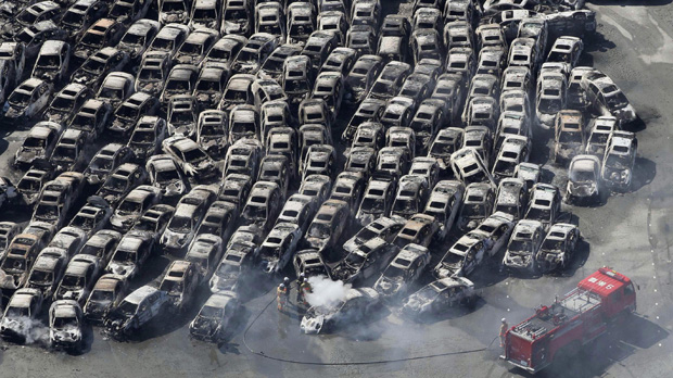 Japan crisis: cars swept away following the earthquake. (Reuters)