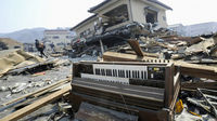 An electric organ swept by a tsunami is seen in Kesennuma, Miyagi Prefecture in northern Japan