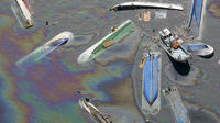 Oil leaks from ships swept by the tsunami after the earthquake