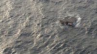 A Japanese home is seen adrift in the Pacific Ocean