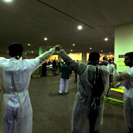 Doctors in a Manama hospital form a human chain - Reuters