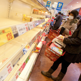 Empty shelves in a Japanese supermarket after radiation concerns fuelled panic-buying.