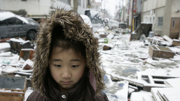 Karen stands in the tsunami ravaged streets of Ishinomaki (save the children)