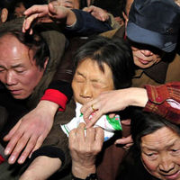 Chinese shoppers crowd into a Beijing supermarket to buy salt