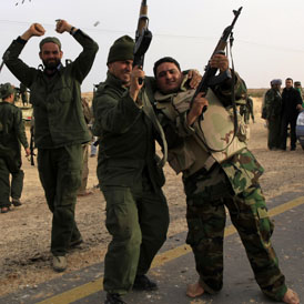 Gaddafi troops celebrate on the outskirts of Ajdabiya (Reuters)