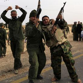 Gaddafi troops celebrate on the outskirts of Ajdabiya (Reuters)