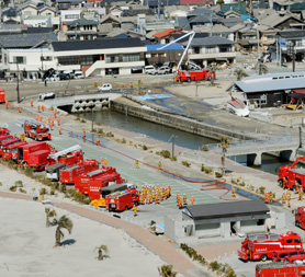 Fire trucks preparing to head to the Fukushima plant (R)