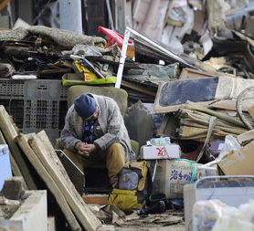 Man in rubble in Kesennuma City, Miyagi Prefecture (R)