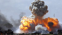 Vehicles belonging to forces loyal to Libyan leader Muammar Gaddafi explode after an air strike by coalition forces, along a road between Benghazi and Ajdabiyah (Reuters)