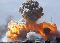 Libya air attack: vehicles belonging to pro_Gaddafi forces explode. (Reuters)