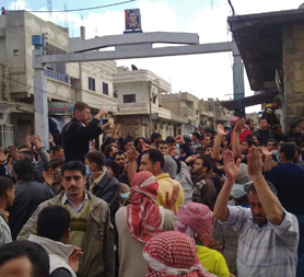 Syrian protesters close to the Omari mosque before the attack