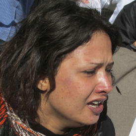 Eman al-Obeidi claims she has been raped and beaten by Gaddafi forces in Libya (Reuters)