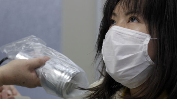 A woman who was evacuated from Fukushima undergoes a test for signs of nuclear radiation at a health centre in northern Japan (Reuters)