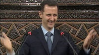 President Assad 30th March (Reuters)