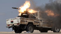 Libyan rebels fire a rocket near Brega. They are being forced to retreat in the face of Gaddafi's advancing forces (Getty)