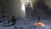 File picture shows firemen working around the World Trade Center after both towers collapsed in New York (Reuters)