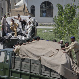 Pakistani soldiers were seen removing the wreckage of the helicopter from the compound in covered trucks after the attack.