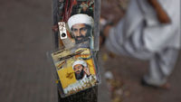 Osama bin Laden: posters show the dead al-Qaeda leader. (Reuters)