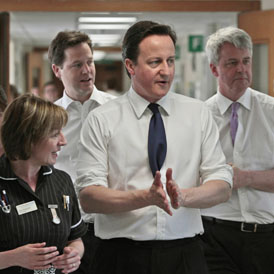 Andrew Lansley (right) with David Cameron and Nick Clegg during a hospital visit (Reuters)