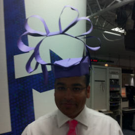 Krishnan Guru-Murthy models the Royal Wedding hat - the origami version