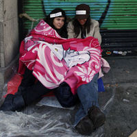 Some 25,000 mostly young people remain camped out in Puerta del Sol for a seventh day of demonstrations against unemployment and austerity measures.