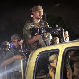 Army soldiers arrive at the Mehran naval aviation base (Reuters)