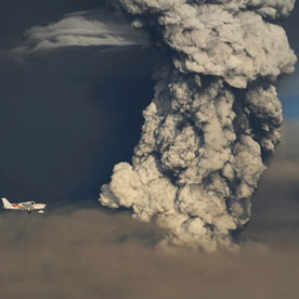 A small plane flies past a smoke plume from the eruption of the Grimsvotn volcano in southeastern Iceland (Reuters)