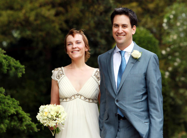 Britain's opposition Labour Party leader Ed Miliband poses with his wife Justine after their wedding in Langar Hall