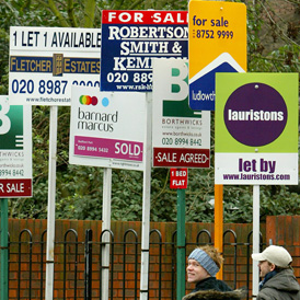 A picture of estate agents boards as a survey finds most first time buyers don't think they will ever be able to afford their own home