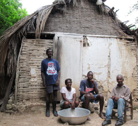Residents in transitional shelter (Medair / Emma Le Beau)